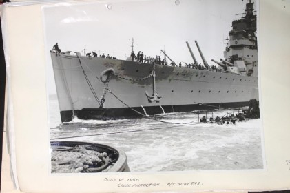 Anti torpedo close protection pontoons in action. King George V class battleship. National Archive.