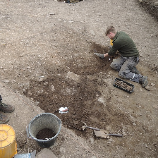 Henrik excavating the upper ditch fills