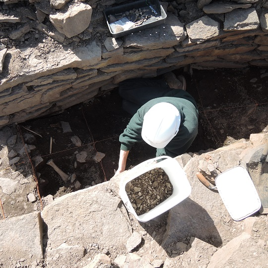Paul excavating animal bones inside the souterrain passage