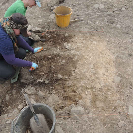 Today's blogger Hanneke and Maria excavating Iron Age soils banked against the natural till