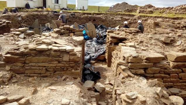 Looking down the entrance of the broch into the interior where the covers where being removed